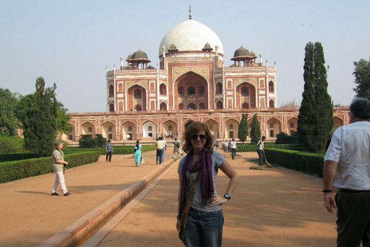 Anna posing in front of a temple in India in 2009.