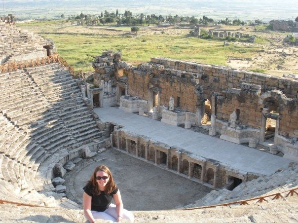 Emily poses in an amphitheater in Turkey, where she did research before graduate school