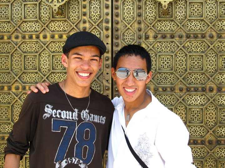 Carlo posing with a friend in Morocco in front of a decorative door