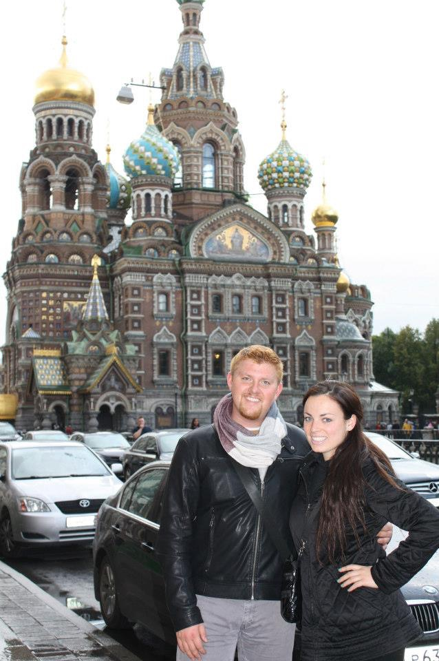 Chris and a study abroad friend pose in front of a Russian building
