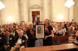 "Lea Bagi (left), from Serbia, presented Assistant Secretary Marie Royce (right), of the Bureau of Educational and Cultural Affairs, with a print of her painting, ""The Beauty of Diversity."""