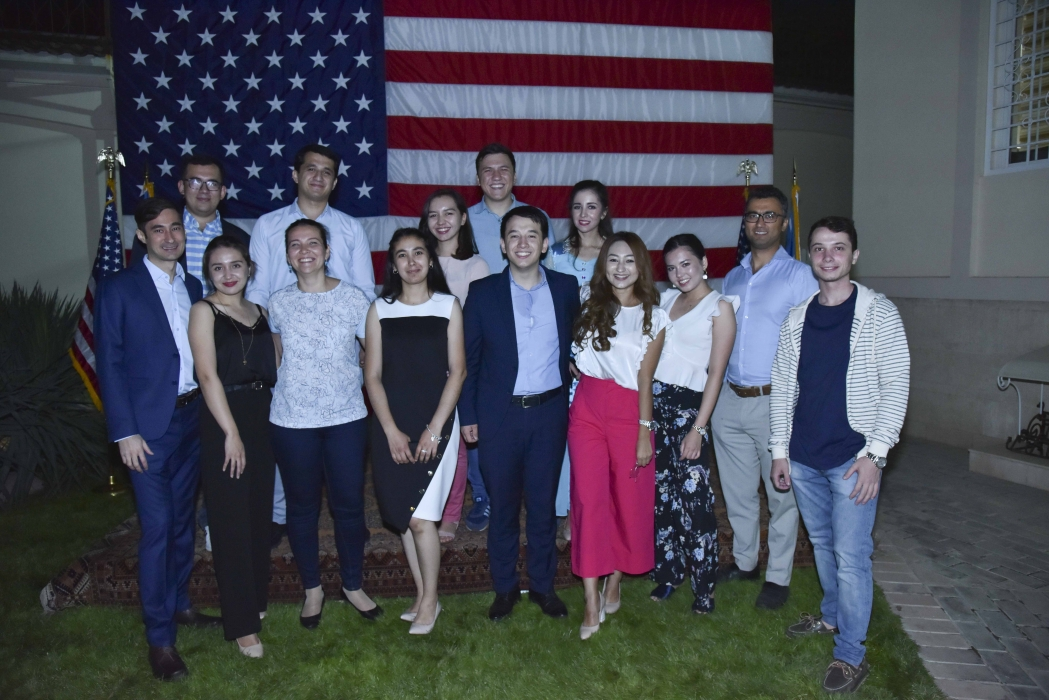 The inaugural group of UBL fellows, posing in front of the American flag