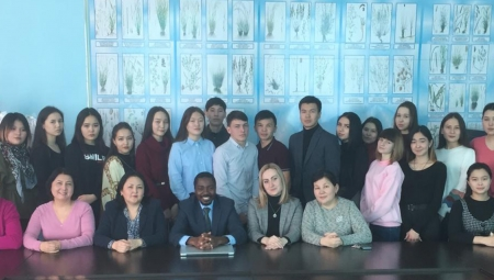 Group of US and Kazakh higher education staff seated together on a site visit in Kazakhstan
