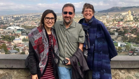 Brian and Sheila Green, with Georgian Fellow, Veka, posing together with views of Tblisi in the background