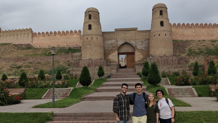Students on the summer Eurasian program posing in front of a castle