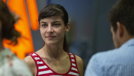 Tamara Kotevska, looks to the left of the camera, wearing a red and white striped top