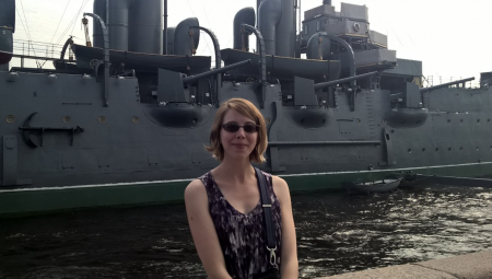 Samantha Williams, posing in front of a ship in Russia